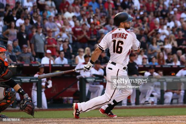 Chris Owings of the Arizona Diamondbacks hits the game winning RBI single against the San Francisco Giants during the ninth inning of the MLB opening...