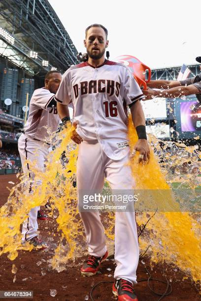 Chris Owings of the Arizona Diamondbacks is dunked with gatorade from Yasmany Tomas and Nick Ahmed after Owings hit the game winning RBI single...