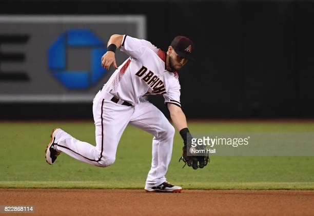 Chris Owings of the Arizona Diamondbacks makes a play on a bouncing ball against the Atlanta Braves at Chase Field on July 24 2017 in Phoenix Arizona