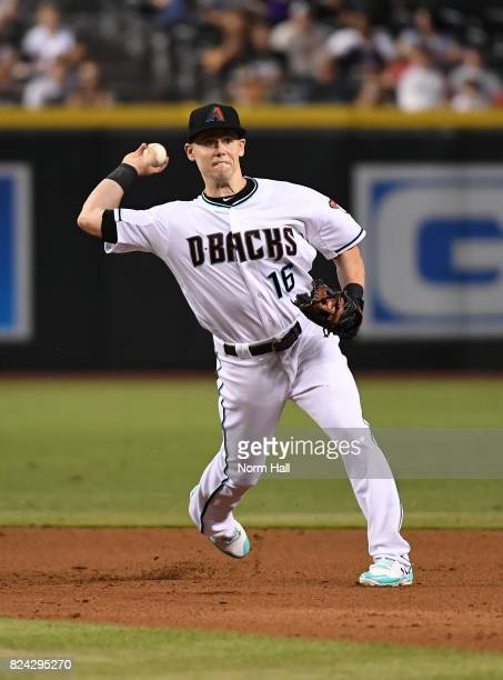 Chris Owings of the Arizona Diamondbacks makes a throw to first base against the Atlanta Braves at Chase Field on July 25 2017 in Phoenix Arizona