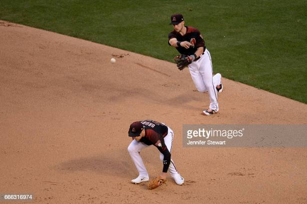 Chris Owings of the Arizona Diamondbacks makes the out over teammate Brandon Drury in the fifth inning against the Cleveland Indians at Chase Field...