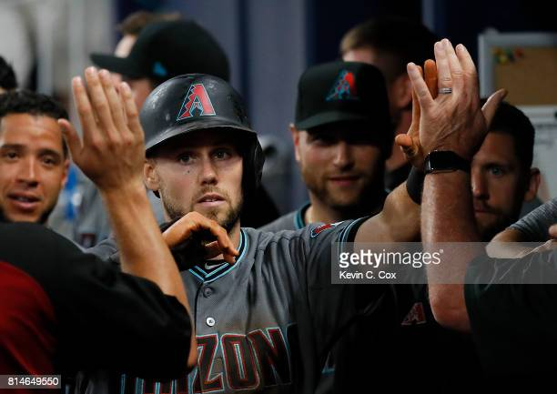 Chris Owings of the Arizona Diamondbacks reacts after scoring on a wild pitch by Jose Ramirez of the Atlanta Braves in the eighth inning at SunTrust...