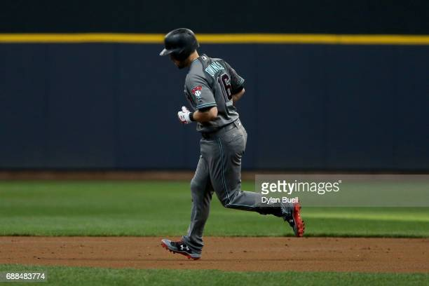 Chris Owings of the Arizona Diamondbacks rounds the bases after hitting a home run in the second inning against the Milwaukee Brewers at Miller Park...