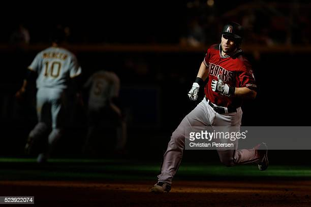 Chris Owings of the Arizona Diamondbacks runs to third base on a RBI triple hit against the Pittsburgh Pirates during the eighth inning of the MLB...