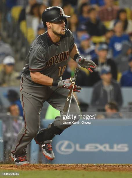 Chris Owings of the Arizona Diamondbacks singles in a run off Clayton Kershaw of the Los Angeles Dodgers in the ninth inning of the game at Dodger...