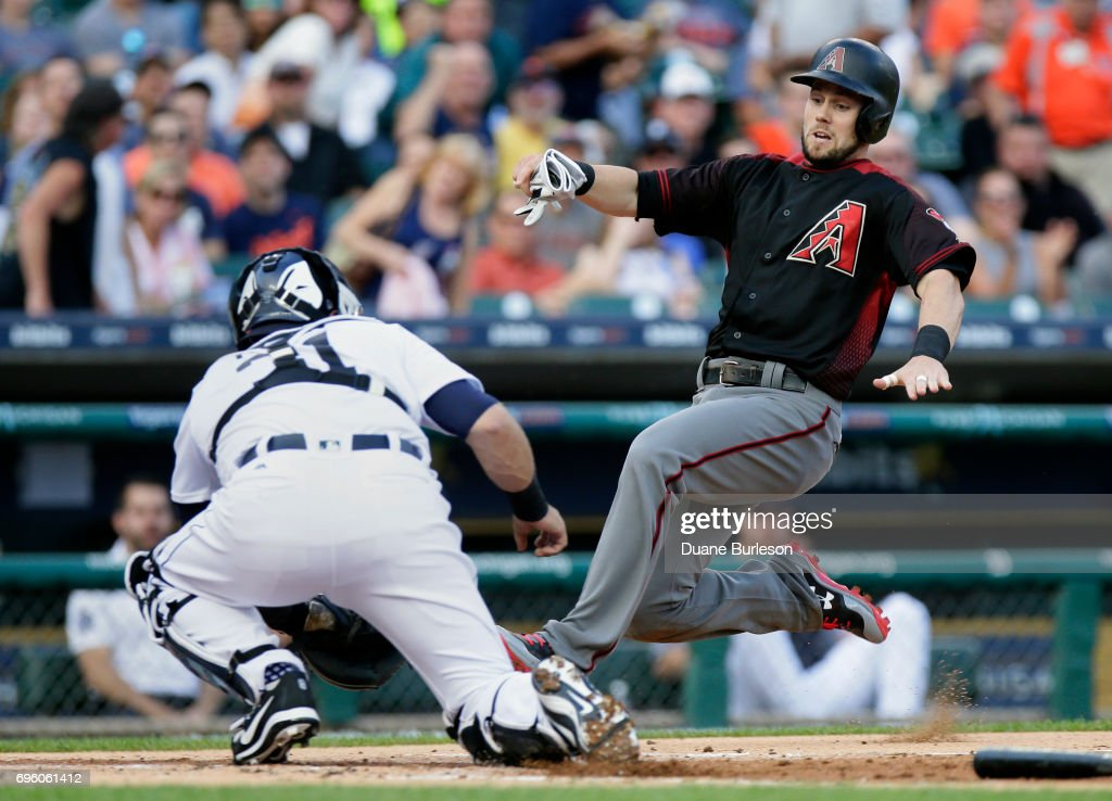 Chris Owings #16 of the Arizona Diamondbacks slides into the tag from catcher Alex Avila #31 of the Detroit Tigers during the first inning at Comerica Park on June 14, 2017 in Detroit, Michigan. Owing attempted to score from from second base on a single by Brandon Drury.
