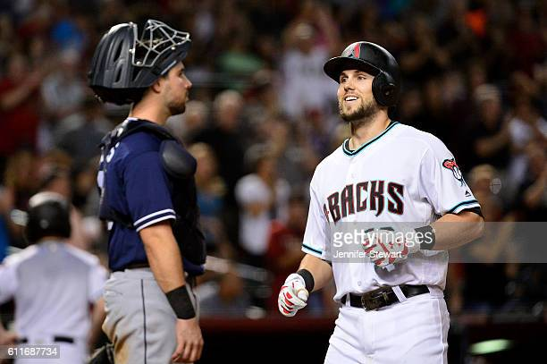 Chris Owings of the Arizona Diamondbacks smiles while crossing home plate after hitting a two run home run in the sixth inning against the San Diego...