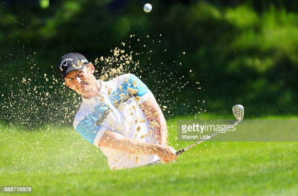 Chris Paisley of England plays from a bunker on the 5th hole during day two of the BMW PGA Championship at Wentworth on May 26 2017 in Virginia Water...