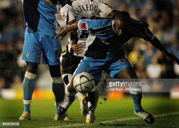 Chris Palmer of Wycombe Wanderers holds off Fulham's Wayne Routledge during the Carling Cup second round match at Craven Cottage in west London