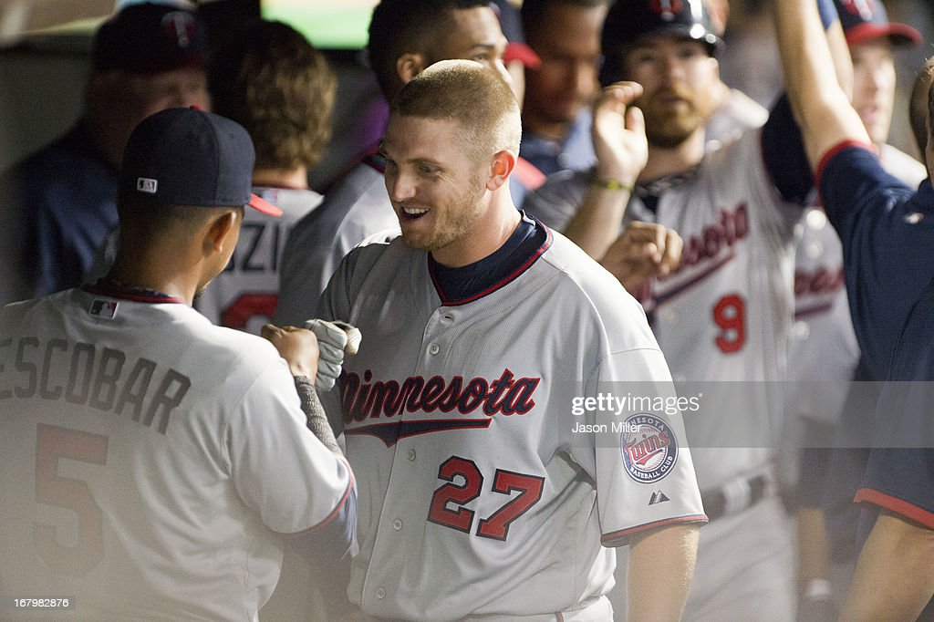 Chris Parmelee #27 of the Minnesota Twins celebrates in the dugout after hitting a two run home run during the seventh inning against the Cleveland Indians to take the lead at Progressive Field on May 3, 2013 in Cleveland, Ohio.