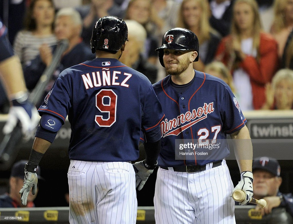 Chris Parmelee #27 of the Minnesota Twins congratulates teammate Eduardo Nunez #9 on a solo home run against the Kansas City Royals during the sixth inning of the game on July 1, 2014 at Target Field in Minneapolis, Minnesota.