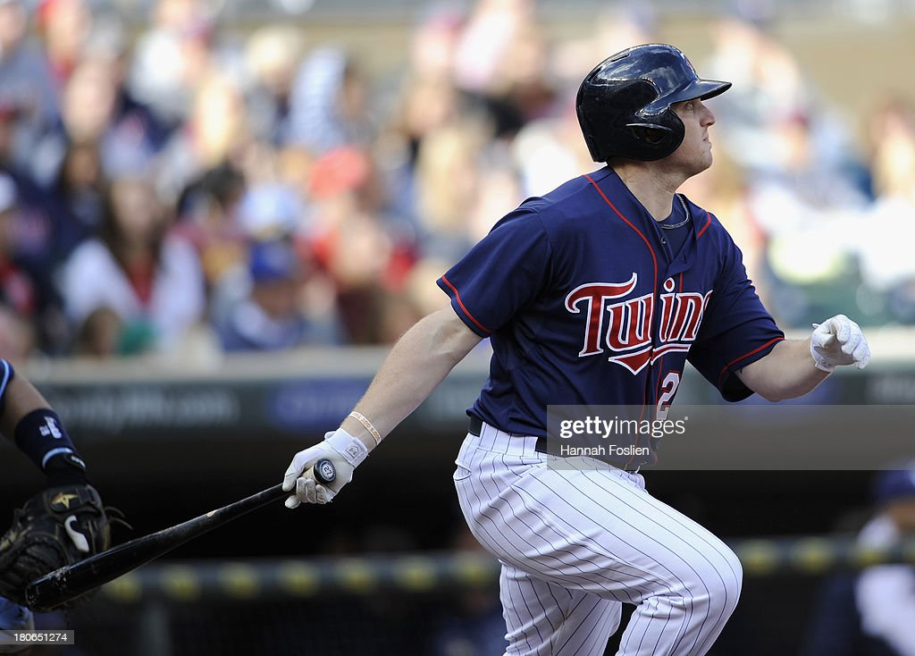 Chris Parmelee #27 of the Minnesota Twins hits a two-run single against the Tampa Bay Rays during the seventh inning of the game on September 15, 2013 at Target Field in Minneapolis, Minnesota. The Twins defeated the Rays 6-4.