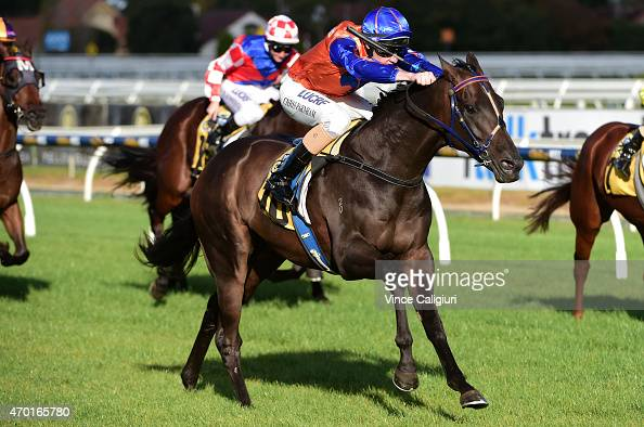Chris Parnham riding Zebrinz wins Race 8 during Melbourne Racing at Caulfield Racecourse on April 18 2015 in Melbourne Australia