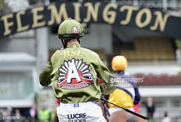Chris Parnham wearing the Anzac Day race colours and riding Lizard Island after Race 2 during Melbourne Racing at Flemington Racecourse on April 25...