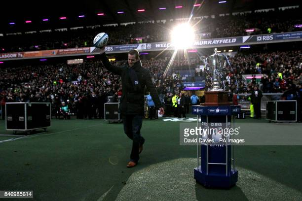 Chris Paterson brings out the matchball before the match