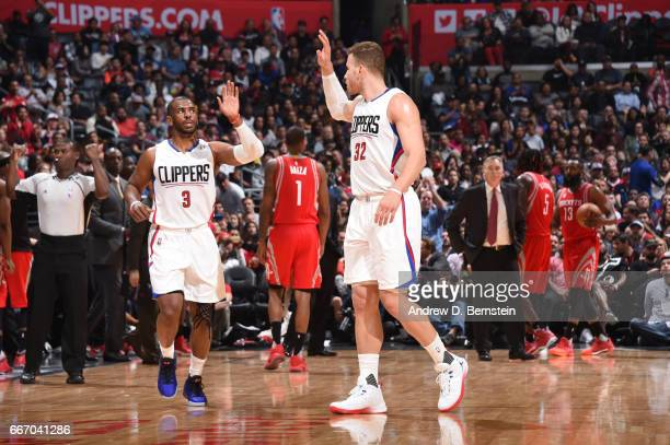 Chris Paul and Blake Griffin of the LA Clippers highfive during a game against the Houston Rockets on April 10 2017 at STAPLES Center in Los Angeles...