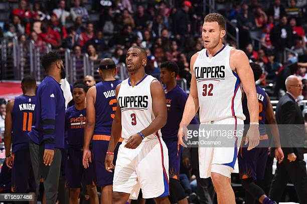 Chris Paul and Blake Griffin of the LA Clippers look on during a game against the Phoenix Suns on October 31 2016 at the STAPLES Center in Los...