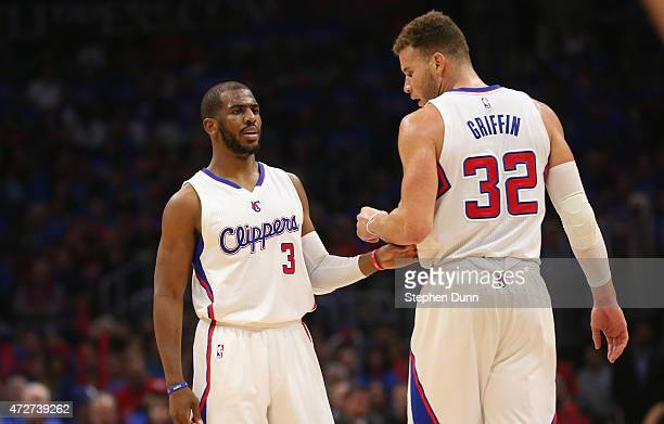 Chris Paul and Blake Griffin of the Los Angeles Clippers confer against the Houston Rockets during Game Three of the Western Conference semifinals of...