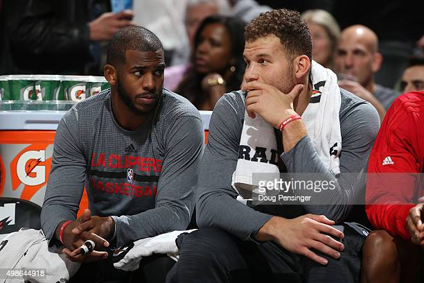 Chris Paul and Blake Griffin of the Los Angeles Clippers look on from the bench against the Denver Nuggets at Pepsi Center on November 24 2015 in...