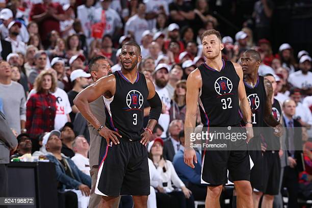 Chris Paul and Blake Griffin of the Los Angeles Clippers looks on against the Portland Trail Blazers in Game Three of the Western Conference...