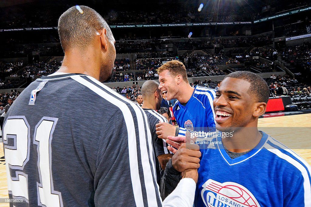 Chris Paul #3 and Blake Griffin #32 of the Los Angeles Clippers smile while greeting Tim Duncan #21 and Tony Parker #9 of the San Antonio Spurs before their game on November 19, 2012 at the AT&T Center in San Antonio, Texas.