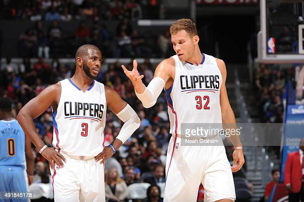 Chris Paul and Blake Griffin of the Los Angeles Clippers talk during the game against the Denver Nuggets at STAPLES Center on October 02 2015 in Los...