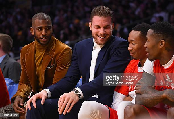 Chris Paul and Blake Griffin talk with Wesley Johnson and Jamal Crawford of the Los Angeles Clippers on the bench in the first half of the game...