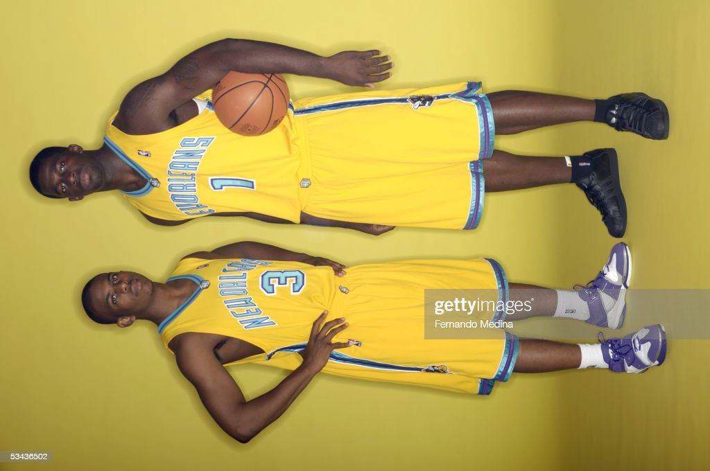 Chris Paul #3 (L) and Brandon Bass #1 of the New Orleans Hornets poses during a portrait session with the 2005 NBA rookie class on August 10, 2005 at the MSG Training Facility in Tarrytown, New York.