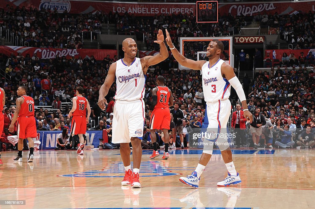 Chris Paul #3 and Chauncey Billups #1 of the Los Angeles Clippers high-five during a game against the Portland Trail Blazers at Staples Center on April 16, 2013 in Los Angeles, California.