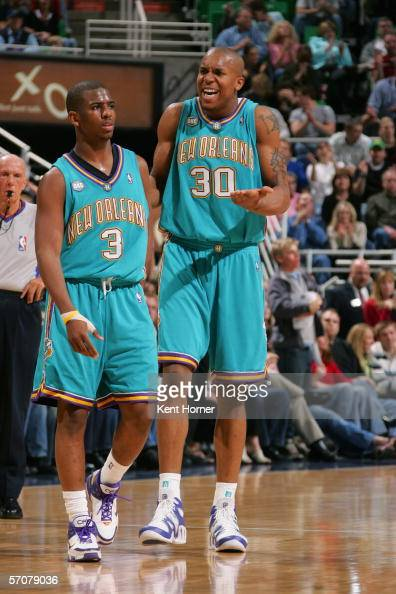 Chris Paul and David West of the New Orleans/Oklahoma City Hornets stand on the court during the game against the Utah Jazz on February 25 2006 at...