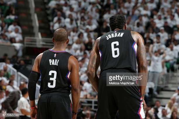 Chris Paul and DeAndre Jordan of the LA Clippers looks on during the game against the Utah Jazz during Game Four of the Western Conference...