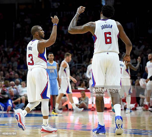 Chris Paul and DeAndre Jordan of the Los Angeles Clippers celebrate a play after a timeout during the game against the Denver Nuggets at Staples...