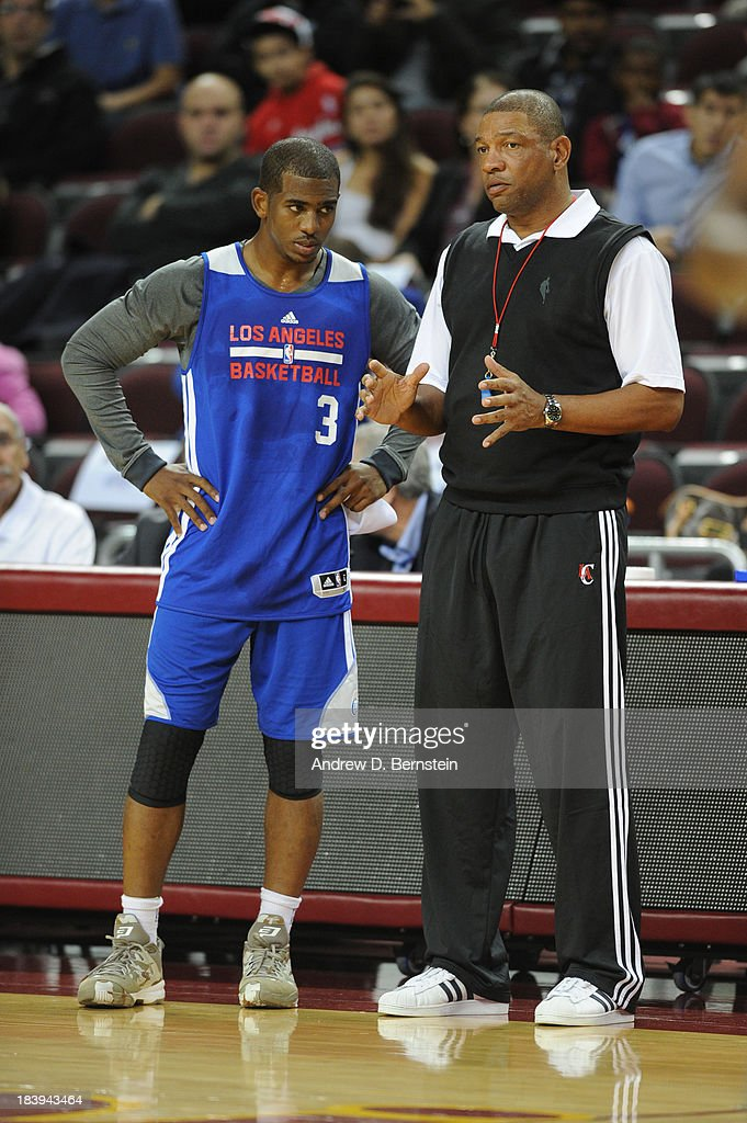 Chris Paul #3 and Doc Rivers of the Los Angeles Clippers converse during an open scrimmage at Galen Center on October 9, 2013 in Los Angeles, California.