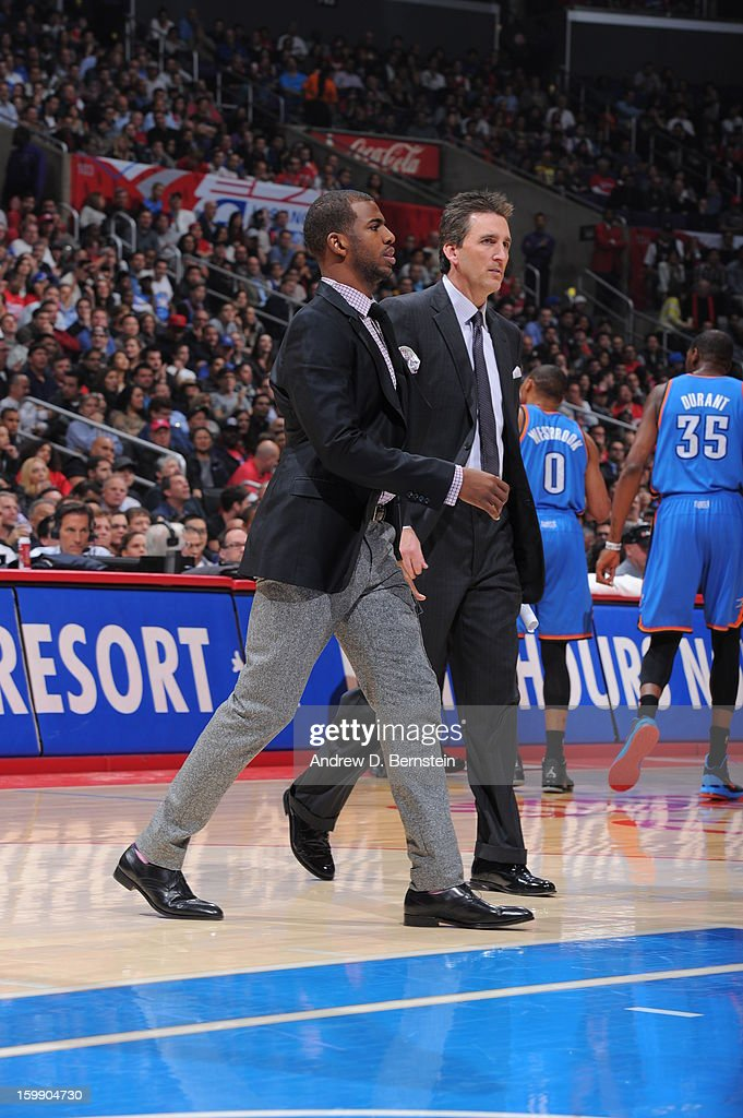 Chris Paul #3 and Head coach Vinny Del Negro of the Los Angeles Clippers walk on the court during a timeout of a game against the Oklahoma City Thunder at Staples Center on January 22, 2013 in Los Angeles, California.