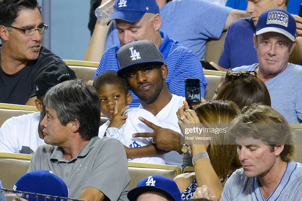 Chris Paul and his son Christopher Emmanuel Paul II attend Game Two of the NLDS between the Los Angeles Dodgers and St Louis Cardinals at Dodger...
