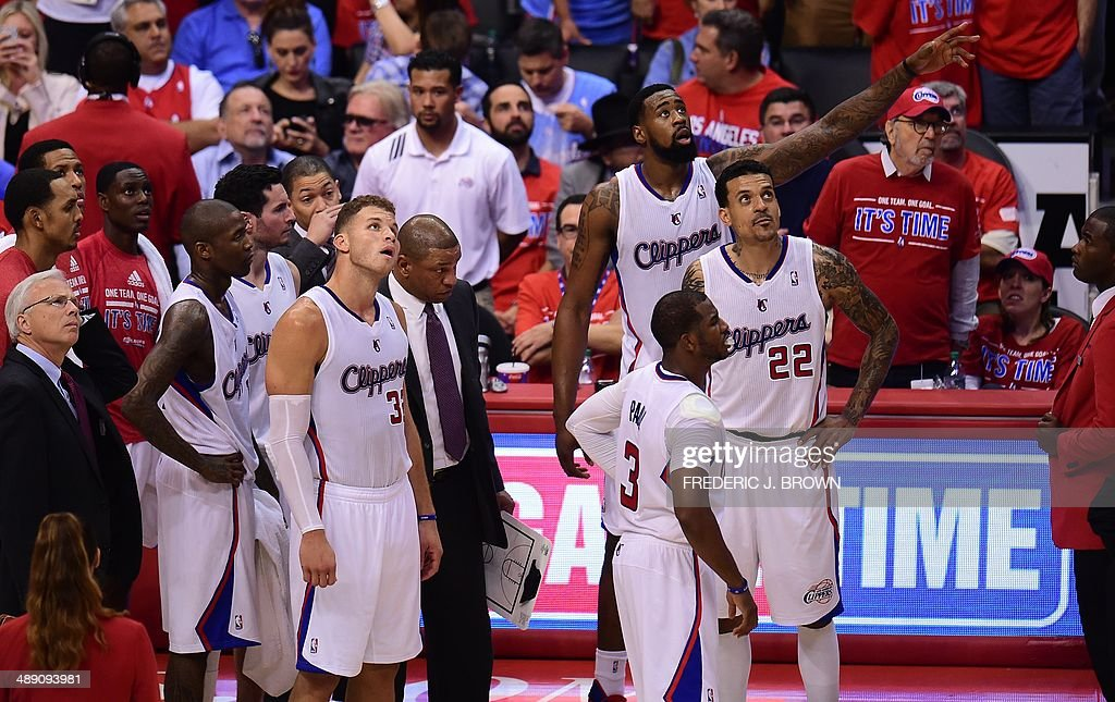 Chris Paul (#3) and his the Los Angeles Clipper teammates watch a replay in the fourth quarter against the Oklahoma City Thunder on May 9, 2014 at Staples Center in Los Angeles, California, during game 3 of their NBA playoff round two series in which the Thunder defeated the Clippers 118-112. AFP PHOTO/Frederic J. BROWN