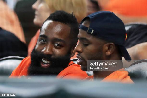 Chris Paul and James Harden of the Houston Rockets attend game two of the American League Championship Series between the Houston Astros and the New...