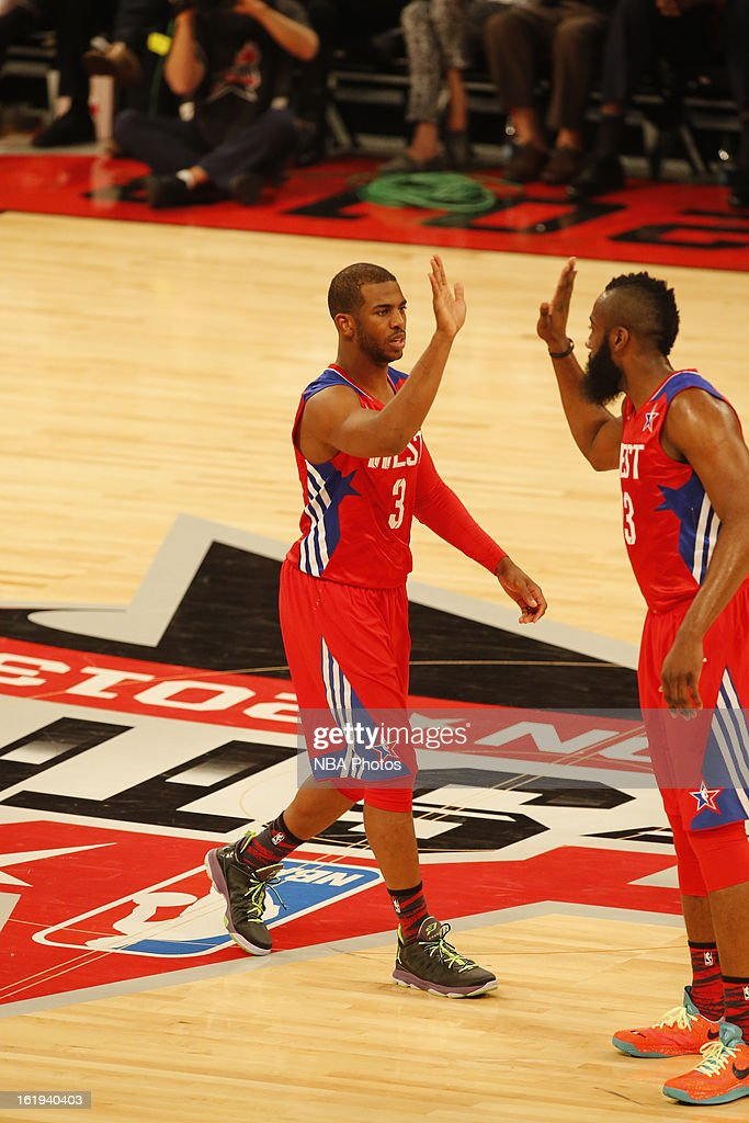 Chris Paul #3 and James Harden #13 of the Western Conference All-Stars walks up the court giving eachother a high five against the Eastern Conference All-Stars during 2013 NBA All-Star Game on February 17, 2013 at Toyota Center in Houston, Texas.