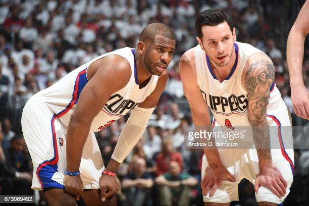 Chris Paul and JJ Redick of the LA Clippers looks on during the game against the Utah Jazz in Game Five of the Western Conference Quarterfinals of...