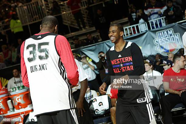 Chris Paul and Kevin Durant of the Western Conference AllStars laugh during NBA AllStar Practice at Sprint Arena as part of 2014 NBA AllStar Weekend...