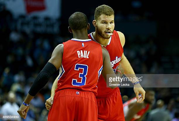 Chris Paul and teammate Blake Griffin of the Los Angeles Clippers hug before their game against the Charlotte Hornets at Time Warner Cable Arena on...