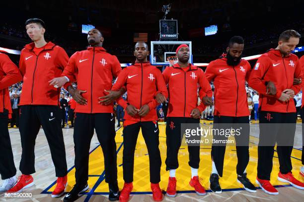 Chris Paul and the Houston Rockets stand on the court for the National Anthem before the game against the Golden State Warriors on October 17 2017 at...