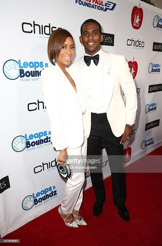 Chris Paul and wife Jada arrive for The CP3 Foundation's Celebrity Server Dinner presented by Apollo Jets at Mastro's Steakhouse on October 26 2014...