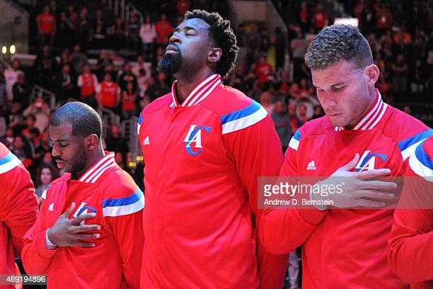 Chris Paul DeAndre Jordan and Blake Griffin of the Los Angeles Clippers stand for the national anthem before a game against the Los Angeles Lakers at...