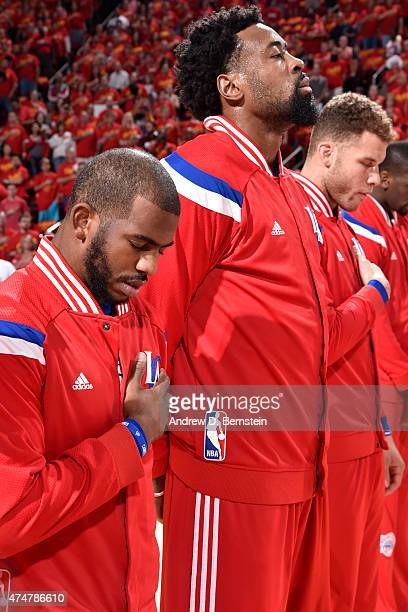 Chris Paul DeAndre Jordan and Blake Griffin of the Los Angeles Clippers stand on the court before Game Seven of the Western Conference Semifinals...