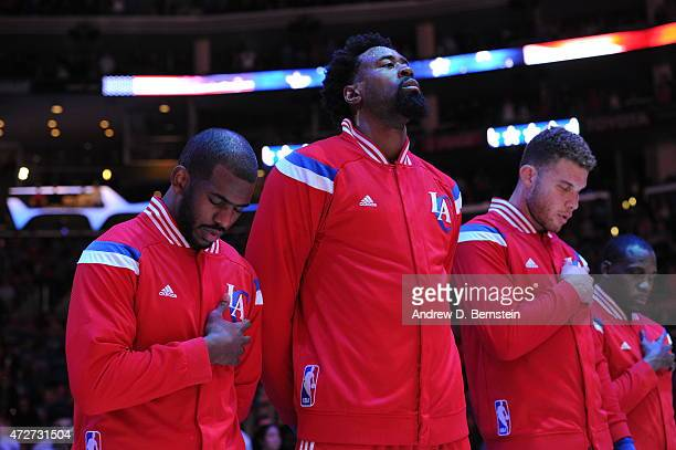 Chris Paul DeAndre Jordan and Blake Griffin of the Los Angeles Clippers during the national anthem before Game Three of the Western Conference...