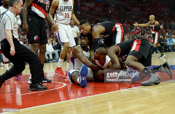 Chris Paul DeAndre Jordan of the Los Angeles Clippers and Damian Lillard Noah Vonleh of the Portland Trail Blazers look for referee Mike Callahan's...