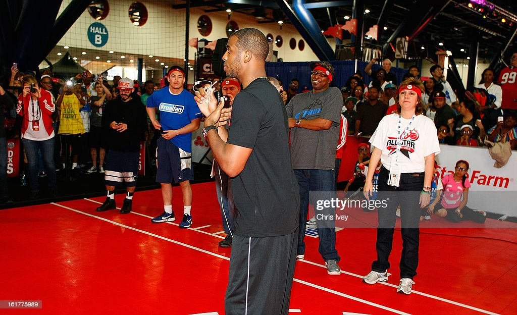 Chris Paul give passing tips to attendees during an appearance in the State Farm Skills Court in Jam Session during NBA All Star Weekend on February 15, 2013 in the George R. Brown Convention Center in Houston, Texas.