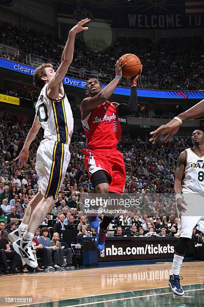 Chris Paul Los Angeles Clippers shoots against Gordon Hayward of the Utah Jazz at Energy Solutions Arena on February 01 2012 in Salt Lake City Utah...