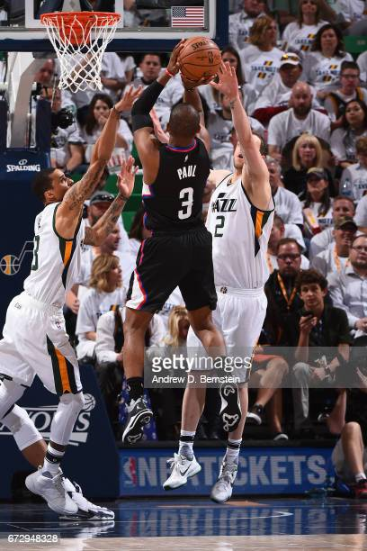 Chris Paul of the LA Clippers drives to the basket and shoots the ball against the Utah Jazz during Game Four of the Western Conference Quarterfinals...